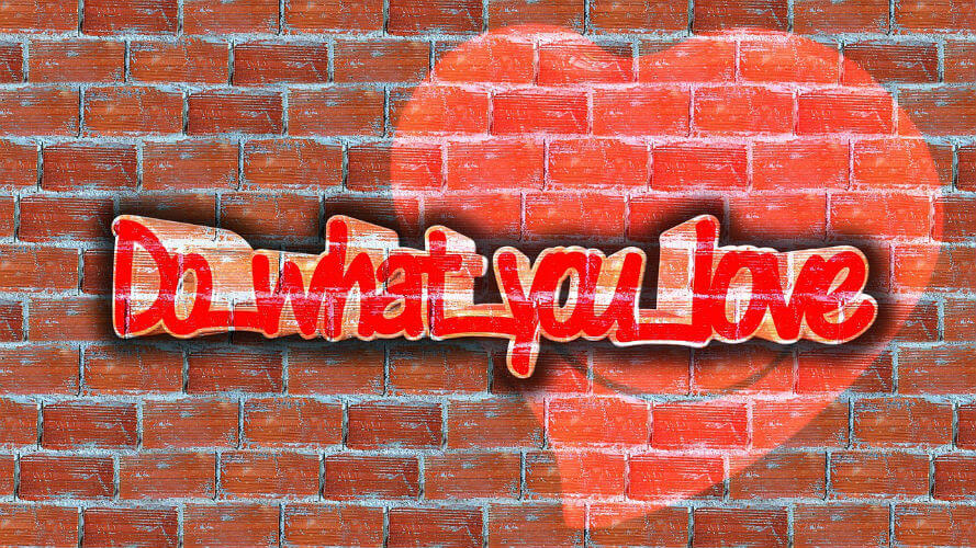Do What You Love written on brick wall with heart on it