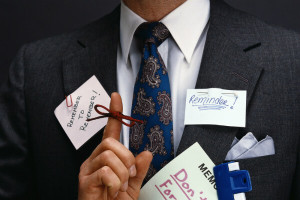 Business man in suit with reminder notes